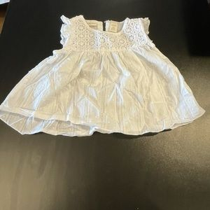 White 24 months sleeveless blouse.